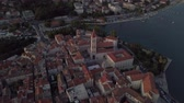 hırvat : Drone goes around historical medieval church in Trogir, Croatia in summer at orange sunset. On the coast of the Adriatic sea.