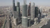 Aerial view on Moscow city skyscrapers and Moscow river. Sunny, blue sky, spring. Cars driving on the motorway. Stockvideo
