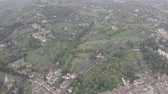 Aerial view of Tuscany landscape in Florence center. Green hills, mountains, cypress trees, orange roofs, Arno river. Italy from drone. Florence from drone