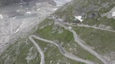 Aerial view of Hotel Belvedere and Furka Pass winding Road in Switzerland, Beautiful Swiss nature, mountains with snow, and Rhone Glacier.