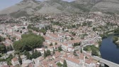 most : Aerial footage of Trebinje Old Town in mountain landscape near Trebisnjica river, Bosnia and Herzegovina. Summer sunny day.