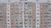 habitação : Aerial pan down footage of windows of modern panel houses. Residential complex, sleeping area. Winter High building. Moscow, Russia.