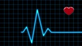 electrocardiograph : Animation Cardiogram and Pulsing Heart on a Black background Stock Footage