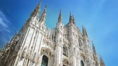 catholic : MILANO, ITALY - MAY 3, 2017: Duomo cathedral timelapse. Front view on square. Gothic architecture.