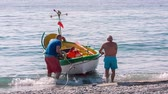 behind : NOLI, ITALY - MAY 7, 2017:Beach of small town Noli in Liguria, on the sea, boats, seagulls