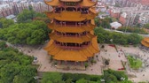 fliege : WUHAN, CHINA - MAY 2, 2017: day time wuhan cityscape yellow crane temple aerial panorama 4k china