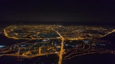 Winter drone shot Minsk city in the night residential and business buildings from above aerial Стоковые видеозаписи