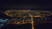 trafik : Winter drone shot Minsk city in the night residential and business buildings from above aerial Stok Video
