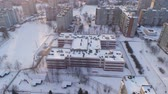 Winter drone shot of the Minsk city suburbs snow sunset residential buildings from above aerial