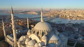 oldal : The Blue Mosque Sultanahmet in Istanbul, Turkie. Aerial drone view Shot. Blue sky, sunset.