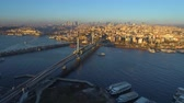 türk : Aerial drone view of the Istanbul, Turkie. Bosphorus Halic bay. Sunny day. Fly over the bridges. Stok Video