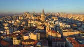 turyści : Galata tower in Istanbul, Turkie. Aerial drone shot from above, city centre, downtown. Sunset.