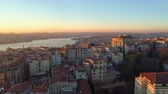 Aerial drone shot of sunset in Istanbul, Turkie. From above, city centre, downtown. Bosphorus