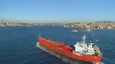 bulker : ISTANBUL, TURKEY - 6 DEC,2017: Ship floating Bosphorus blue water sunny day. Aerial drone view on sunset.