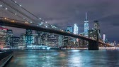 beautiful building : Manhattan skyline and Brooklyn bridge at night. Timelapse. Tall buildings on background, New York, NYC