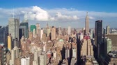 império : Aerial view of Manhattan, New York City. Skyscrapers around. Sunny day, aerial timelapse dronelapse Vídeos