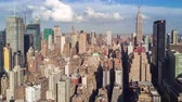 colocar : NEW YORK, USA - MAY, 2018: Aerial view of Manhattan, tall buildings. Sunny day, aerial timelapse dronelapse.