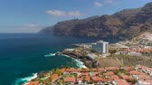 TENERIFE, LOS GIGANTES, SPAIN - MAY 18, 2018: Aerial view rocky coast and hotels, Canary islands.