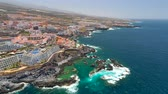 kanári szigetek : TENERIFE, LOS GIGANTES, SPAIN - MAY 18, 2018: Aerial view rocky coast and hotels, Canary islands.