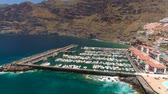 テネリフェ島 : TENERIFE, LOS GIGANTES, SPAIN - MAY 18, 2018: Aerial view of modern sail boats, yachts in a seafront