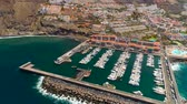 TENERIFE, LOS GIGANTES, SPAIN - MAY 18, 2018: Aerial view of modern sail boats, yachts in a seafront
