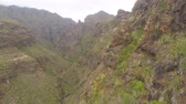 высокий : Aerial view of rocky mountains in Hell gorge, Canary islands Стоковые видеозаписи