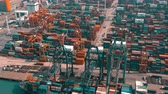 HONG KONG - MAY 1, 2018: Aerial view of a modern port container terminal. Large ship loading. Stock mozgókép