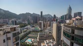 HONG KONG - MAY 2018: Day to night rooftop timelapse view of Wan Chai disrtict, city from above. Stock mozgókép