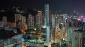 HONG KONG - MAY 2018: Rooftop timelapse view of Causeway Bay and Wan Chai disrtict, city from above at night. Stock mozgókép