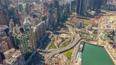 HONG KONG - MAY 2018: Aerial view of Causeway Bay and Victoria Bay, heavy road traffic and skyscrapers.