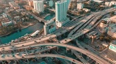 Майами : MIAMI, FLORIDA, USA - MAY 2019: Aerial drone view flight over Miami downtown. Road viaduct and overpass from above.