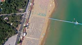 şemsiye : Lignano beach at Adriatic sea coastline in Italy aerial drone view. Europe during summer. Stok Video