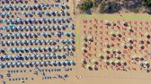 şemsiye : LIGNANO, ITALY - MAY, 2019: Lignano beach at Adriatic sea coastline in Italy aerial drone view. Europe during summer.