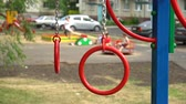 체조 : Gymnastic rings on the playground in the yard. Unfocused children on background