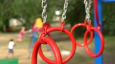 houpavý : Gymnastic rings on the playground in the yard. Unfocused children on background