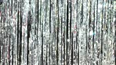 ティンセル : Silver rain from tinsel. Dynamic background in shining lights and sparkling particles. Beautiful silver background with shiny silver glitter sparkles. Festive mood. Christmas or holiday theme