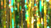 ティンセル : Magic abstract shiny background with colored defocused bokeh. Beautiful dynamic background in shining lights and sparkling particles. Festive mood. Christmas or holiday theme