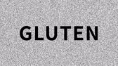 artifacts : Gluten Harmful food. Word about food problem on noisy screen. Looping VHS interference. Stock Footage