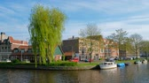 Boats, houses in canal. Harlem, Netherlands