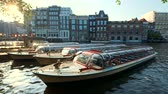 Amsterdam tourist boats in canal