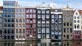hollandalı : houses and boat on Amsterdam canal Damrak with reflection. Ams Stok Video