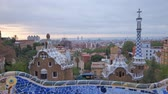 всемирного наследия : Barcelona city view from Guell Park. Sunrise view of colorful mosaic building in Park Guell.