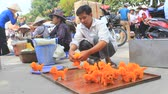 female : HAI DUONG, VIETNAM, SEPTEMBER, 10 2014: Man selling cotton dog toy in the market, Vietnam