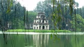 people : Hoan Kiem lake with the Tortoise Tower, symbol of Hanoi, Vietnam
