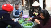 curry : Haiduong, Vietnam, December, 24, 2014: Women pounding stone ginger with a mortar  Stock Footage
