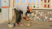 shale : install stone wall surface worker with cement, Vietnam Stock Footage