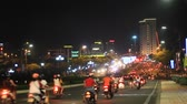 марш : Traffic with motorcycles in Asian cities at night