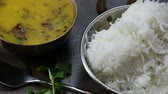 Arahar daal fry on yellow lentil fry with white Basmati rice an Indian Daal Chawal Stock Footage