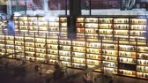 escritor : Biblioteca Museo Nacional Centro de Arte Reina Sofia. Glowing bookshelves. Tilt up real time medium shot