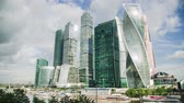 new capital : Time lapse of Moscow city skyscrapers with clouds and cars riding around. Concept of a city life Stock Footage